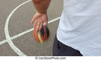 Hand dribbles the basketball ball