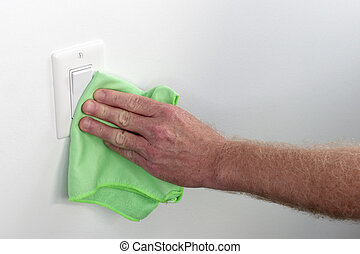 Hand Dusting and Cleaning Flat Light Switch Panel