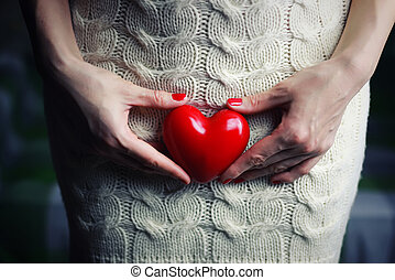 Hand female holding heart - object red heart-shaped hands...