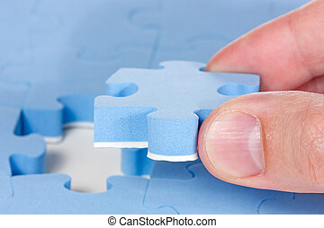 Hand fitting the last puzzle piece