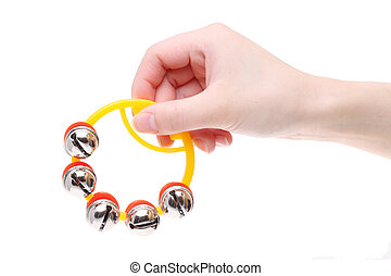 Hand folding colorful jingle bell on a white background