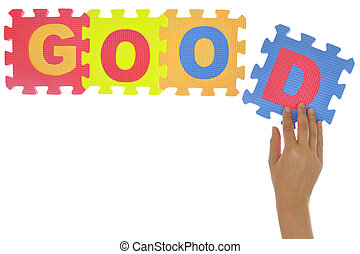"Hand forming word ""Good"" with jigsaw puzzle pieces isolated"