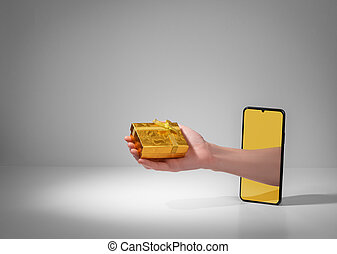 Hand giving a beautiful golden gift box from out of phone screen