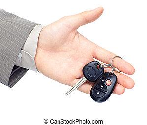 Hand giving a car key.
