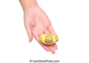 Hand giving gold ingot to someone for Chinese New Year celebration