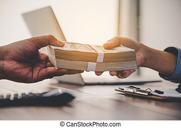 Hand giving money - United States Dollars . Hand receiving money from businessman