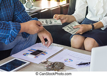 Hand giving money - United States Dollars (or USD), Hand receiving money from businessman, Venality, bribe, corruption concept.