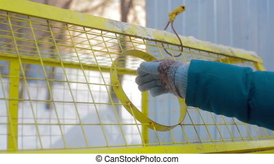 Hand giving plastic bottle in recycle bin Garbage separation...