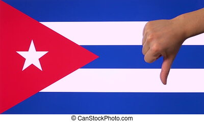 Hand giving thumb down with Cuba flag disapproval gesture with copy space