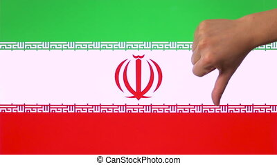 Hand giving thumb down with Iran flag disapproval gesture...