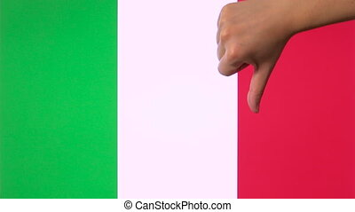 Hand giving thumb down with Italy flag disapproval gesture with copy space
