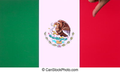Hand giving thumb down with Mexico flag disapproval gesture with copy space