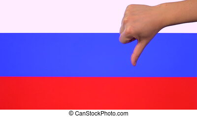 Hand giving thumb down with Russia flag, disapproval gesture with copy space