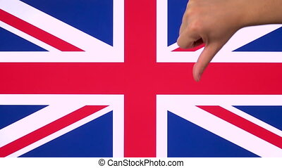 Hand giving thumb down with United Kingdom flag disapproval gesture with copy space