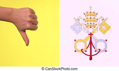 Hand giving thumb down with Vatican City State flag...