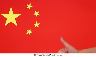 Hand giving thumb up with China flag, approval gesture with copy space