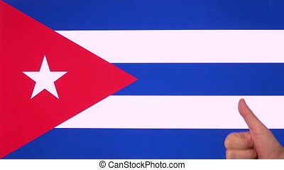Hand giving thumb up with Cuba flag, approval gesture with copy space