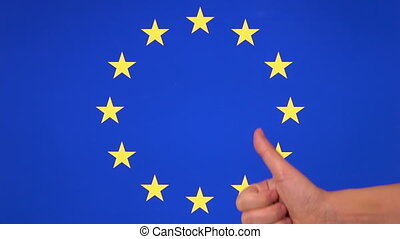 Hand giving thumb up with European Union flag, approval gesture with copy space