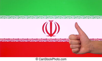 Hand giving thumb up with Iran flag, approval gesture with copy space