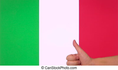 Hand giving thumb up with Italy flag, approval gesture with...