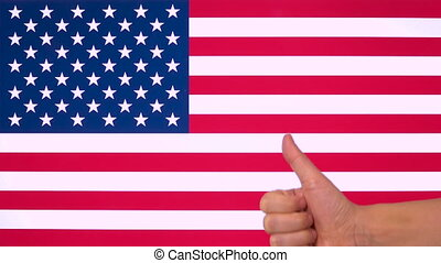Hand giving thumb up with Usa flag, approval gesture with copy space, liking