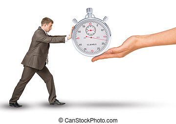 Hand giving timer to businessman