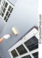 hand glove holding paint brush