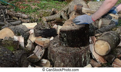hand gloves chopping wood - hands with gloves chopping wood...