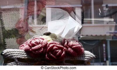 Hand Grabbing A Tissue Window side
