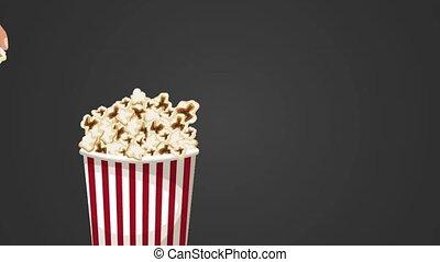 Hand grabbing popcorn from box HD animation - Hand grabbing...