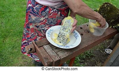 hand grater potato - senior woman hand shredder potato with...