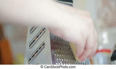 hand grating yellow cheese