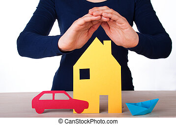 Womans Hands Guarding a House, a Car and a Boat, Isolated