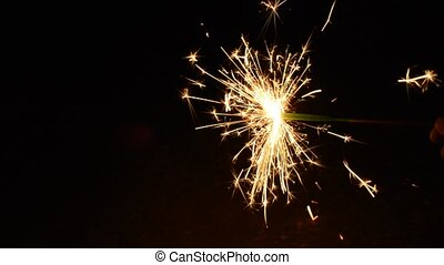Hand held firework - Burning small hand held firework on a...
