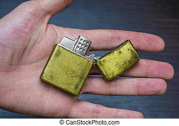 hand-held golden folding lighter