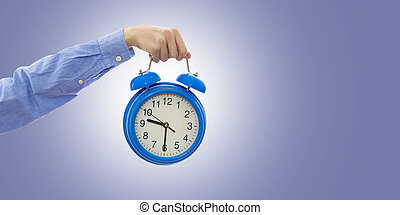hand-held or alarm clock insulated in blue background