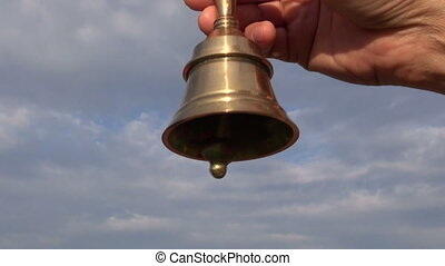 hand hold  brass jingle bell