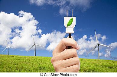 hand hold eco power plug and Wind turbines on blue sky