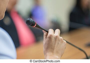 hand hold Microphone in meeting room for a conference