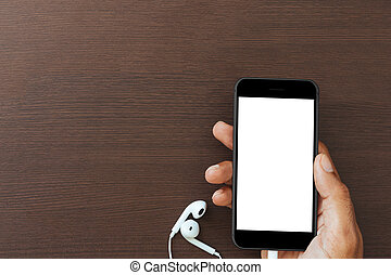 hand hold phone white screen on wood table, mockup new smart phone modern style matte black color