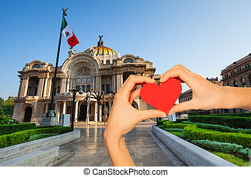 Hand hold red heart, palace of fine arts Mexican