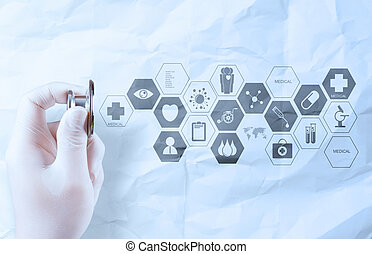 hand hold stethoscope showing medical concept on crumpled ...