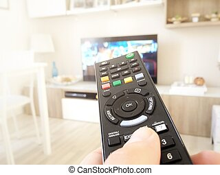 Hand hold the television remote control