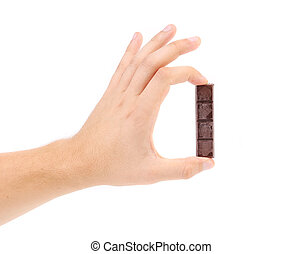 Hand hold three pieces of chocolate.