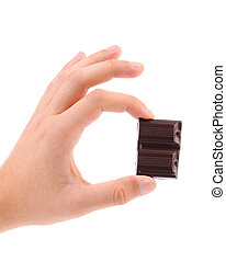 Hand hold two pieces of chocolate