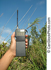 hand hold walky talky at field