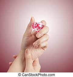 hand holding 3d red heart shape of diamond