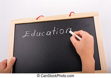 Hand holding a blackboard