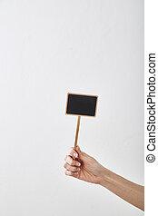hand holding a blank blackboard label
