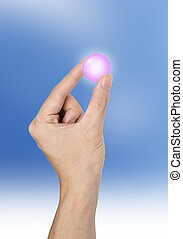 Hand holding a blue crystal ball shine isolated on sky background